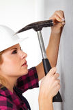 Young woman with a hammer Royalty Free Stock Image