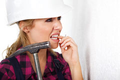Young woman with a hammer Royalty Free Stock Photography