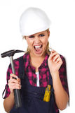 Young woman with a hammer Stock Photography