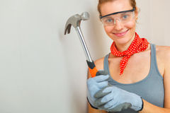 Young woman with hammer in hands Stock Photography
