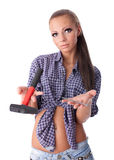 Young woman with hammer and nail Stock Photography