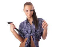Young woman with hammer and nail Royalty Free Stock Photos