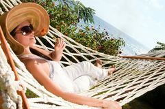 Young woman in hammock Stock Image