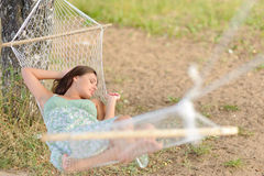 Young woman on hammock Royalty Free Stock Photos