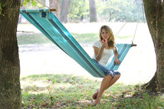 Young woman in a hammock Stock Photography