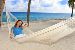 Young woman in hammock on background of palm trees Stock Photography
