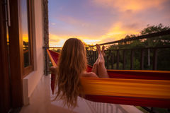 Young woman in the hammock Stock Images
