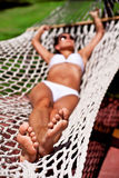 Young woman in hammock. Stock Photos