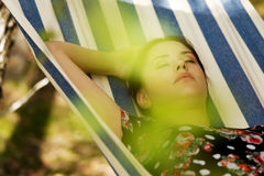 Young woman in hammock Royalty Free Stock Photos