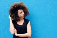 Young woman with hand in afro hair. Portrait of young woman with hand in afro hair Stock Image