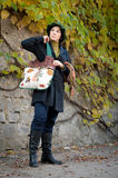 Young woman with hand bag Royalty Free Stock Photography