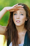 Young woman with hand closes eyes Royalty Free Stock Photography