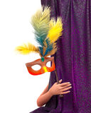 Young woman hand with curtain and carnival mask Royalty Free Stock Photography