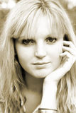 Young woman with hand on face. In sepia Royalty Free Stock Photos