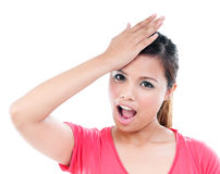 Young Woman With Hand On Forehead Royalty Free Stock Images