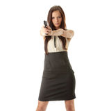 Young woman with hand gun Royalty Free Stock Images