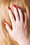 Young woman hand and hair Royalty Free Stock Image