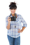 Young woman with hand on her hip taking picture Stock Photo