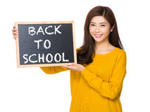 Young woman hand hold with the blackboard showing phrase of back Royalty Free Stock Photography