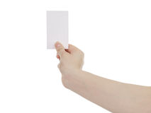 Young woman hand hold and showing empty paper card. On white background Stock Photo