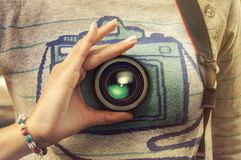 Young woman hand holding camera lense, photographer Stock Image