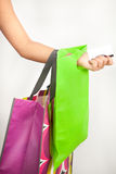 Young woman hand holding card and shopping bags Stock Images