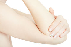 Young woman hand holding elbow in pain isolated. On white, clipping path Stock Photography