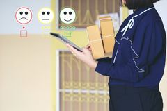 Young woman hand holding smartphone and putting check mark with smiley face marker and green marker on five stars of delivery. Package, Satisfaction evaluation royalty free stock photos