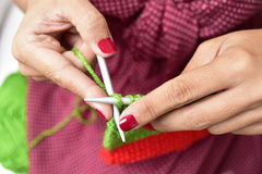 Young woman hand knitting Stock Images