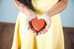 Free Young Woman Hand Red Heart In Studio. Stock Images - 214985104
