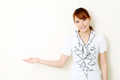 Young woman hand showing blank sign. Young japanese woman hand showing blank sign Stock Photo