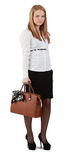 Young woman with handbag. Against a white background Royalty Free Stock Photography