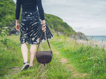 Young woman with handbag in nature Stock Photography