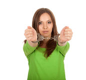 Young woman with handcuffed hands Royalty Free Stock Photos