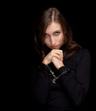 Young woman with handcuffed hands, Royalty Free Stock Images