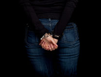 Young woman with handcuffed hands Stock Photography