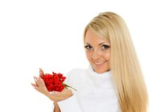 Young  woman with a handful of berries. Stock Photo