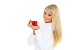 Young  woman with a handful of berries. Royalty Free Stock Image