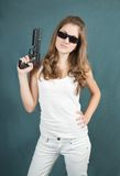 Young woman  handgun. A stunningly beautiful young woman posing with a handgun Stock Images