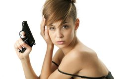 Young woman with handgun Royalty Free Stock Photography