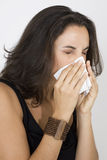 Young woman with a handkerchief. Young woman sneezing in a handkerchief Stock Photos