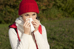 Young woman with handkerchief and flu Stock Photography