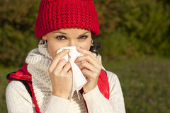 Young woman with handkerchief and flu Royalty Free Stock Photography