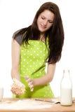Young woman handling dough Stock Photo