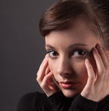 Young Woman With Hands on Face Royalty Free Stock Photos