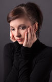 Young Woman With Hands on Face Stock Image