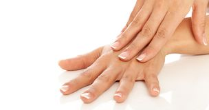 Young woman hands with french manicure Stock Photos