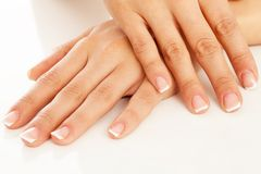 Young woman hands with french manicure Royalty Free Stock Photography