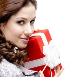 Young woman hands a gift, close up. Young woman hands a gift wrapped in red paper, isolated on white, close up Stock Photo
