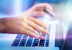 Young woman hands holding credit card and using laptop computer Royalty Free Stock Photos